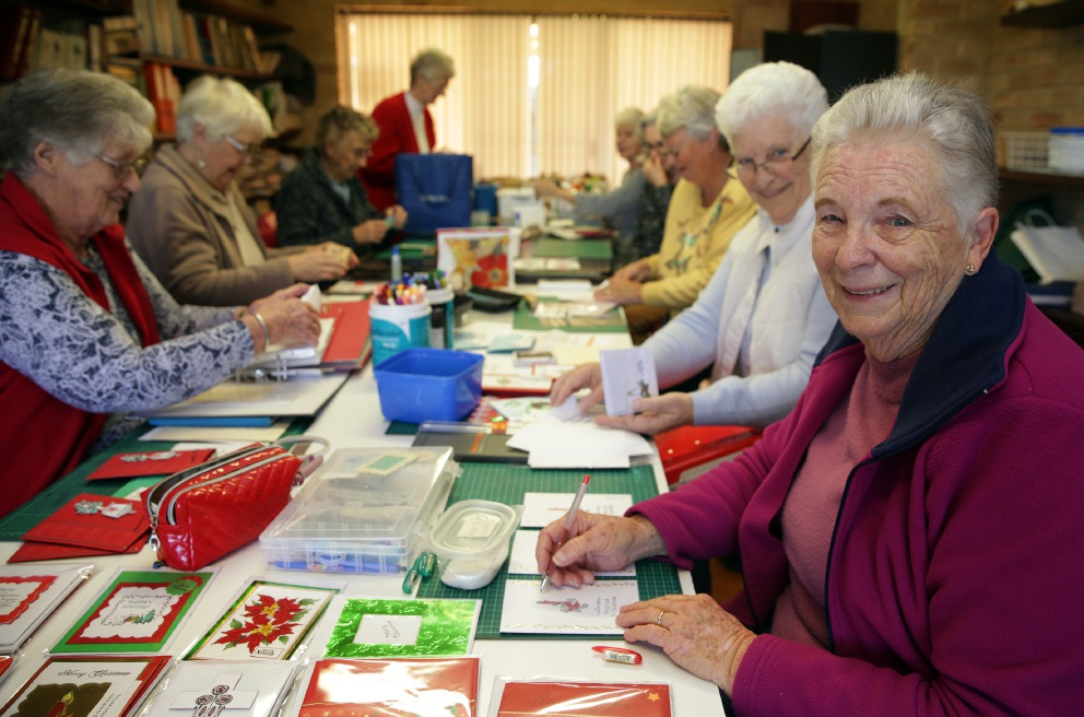 Joy Padman and other members of the group making cards to send to overseas troops. Picture: Martin Kennealey          d458514