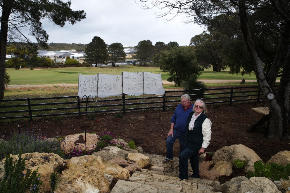 """Barry and Heather Powell say the new fences are """"like a prison."""" www.communitypix.com.au   d459805"""