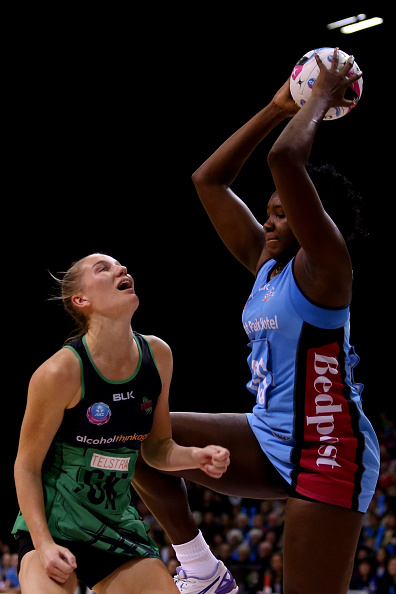 Jhaniele Fowler-Reid, right, grabs the ball ahead of Courtney Bruce of the West Coast Fever. Picture: Dianne Manson/Getty Images.