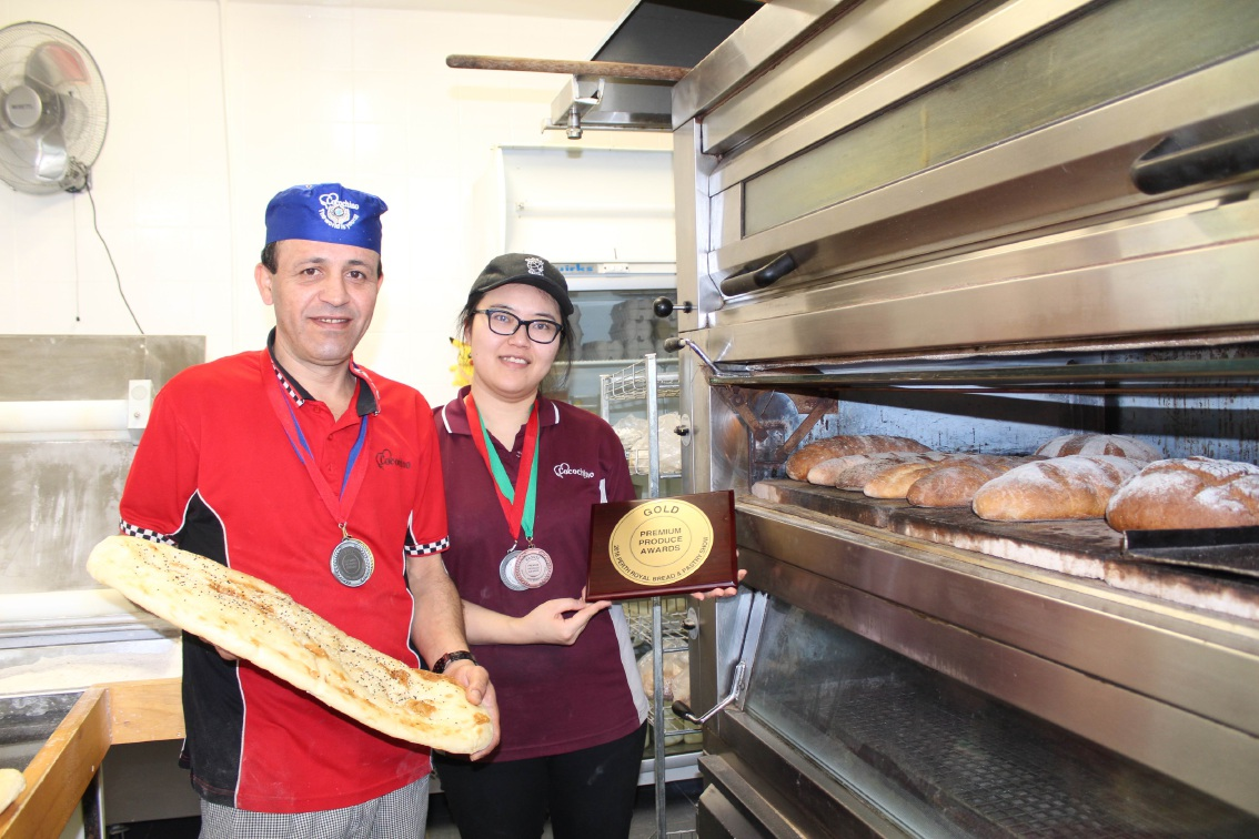 Bakery owner Haider Alkaabi and Meng Zhang with a selection of the winning breads.