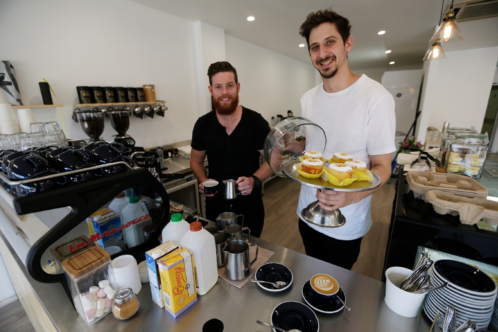 Barista Taylor Landquist with Nick Gianotti at Sondrea Espresso.  Picture: Andrew Ritchie         www.communitypix.com.au   d459558
