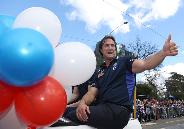 Western Bulldogs head coach Luke Beveridge waves to fans during the 2016 AFL Grand Final Parade. Picture: Robert Cianflone/Getty Images.