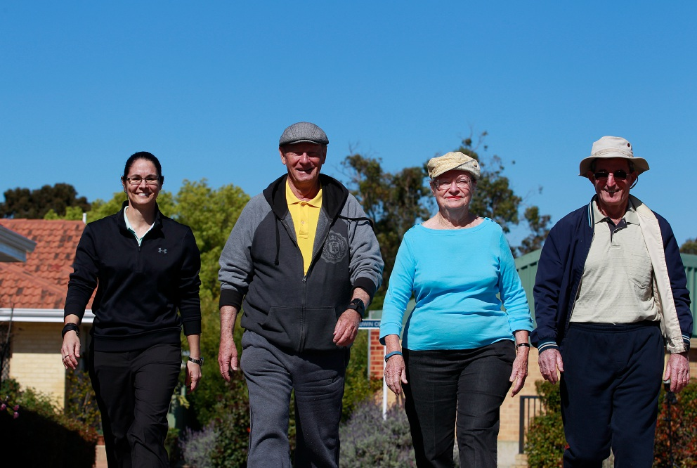 Elissa Burton (Research Fellow Curtin University), Con Hofstee (SwanCare resident) and Yvonne and Ken Power (SwanCare residents) wearing their Fitbits. Picture: Marie Nirme