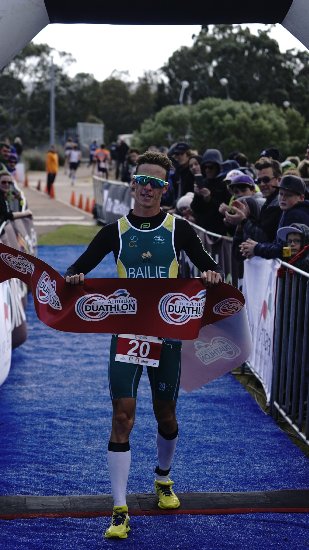 Ryan Bailie crosses the line at the City of Armadale Duathlon at Champion Lakes Regatta Centre.