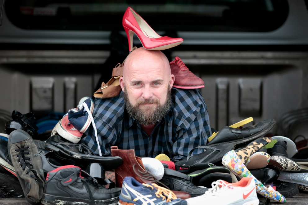Scott Harvey with some of the shoes. Picture: Andrew Ritchie www.communitypix.com.au   d459974