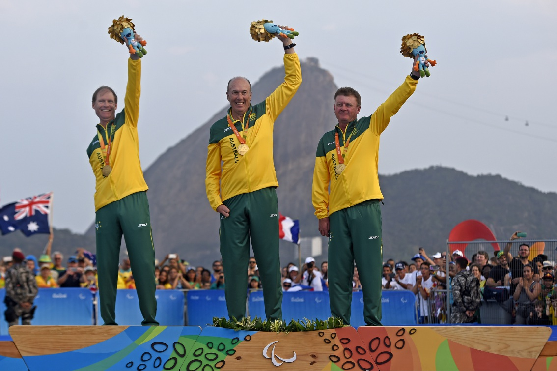 COLIN Harrison (left) and his crew-mates Jonathan Harris and Russell Boaden with their gold medals at the Rio Paralympics. Picture: Australian Paralympic Committee