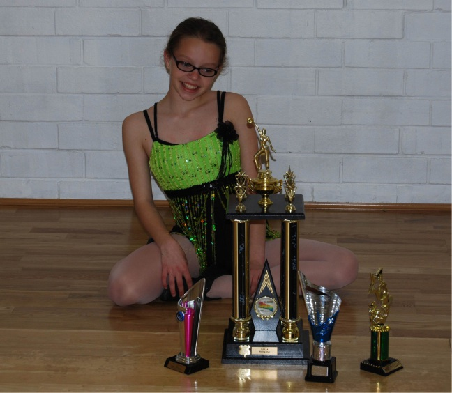 Abigail Pedley (12) with her awards.