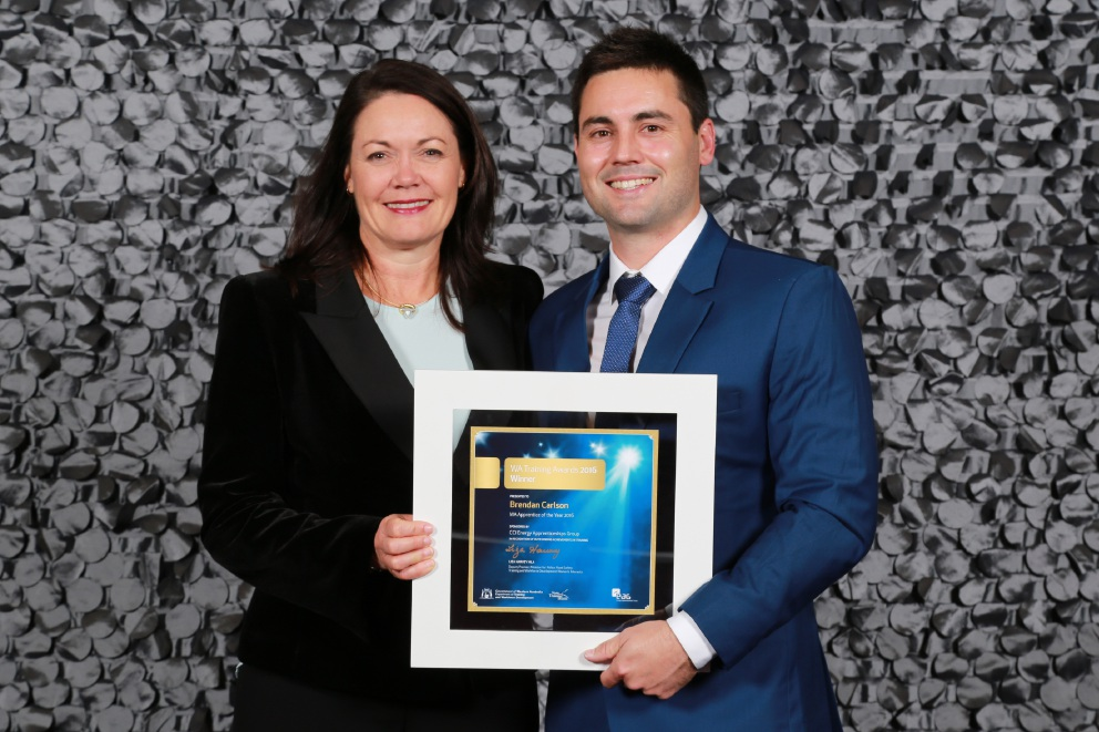 Brendan Carlson receives his award from Training and Workforce Development Minister Liza Harvey.