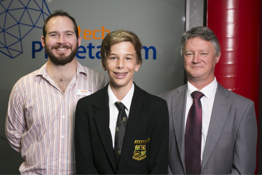 Scitech master of challenges Thomas Coe with Jonathon Parker and department of education senior consultant Michael Comber. Picture: Daniel Grant.