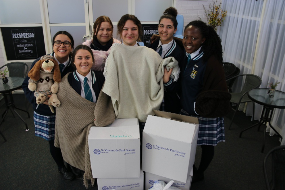 Children, Family and Community class students with some of the blankets donated to St Vincent de Paul Society.