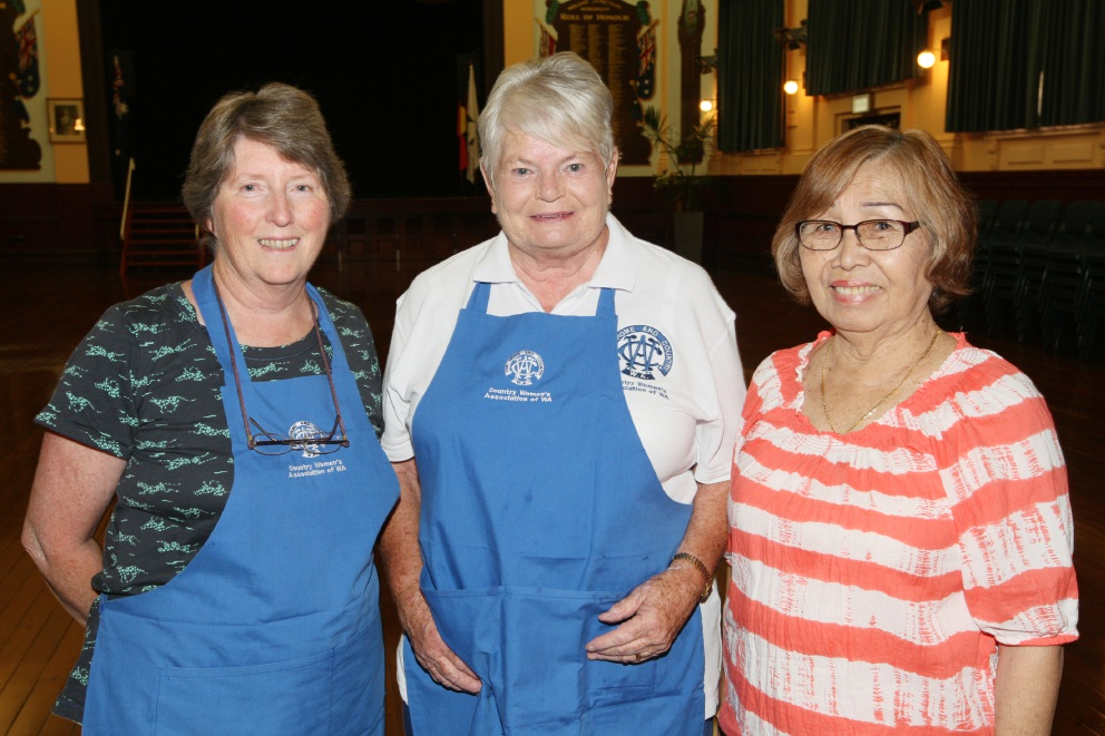 Maxine Wood and Maureen Baker speaking to Zeni Jupp about the dishes made at last year's CWA cooking classes. Picture Bruce Hunt