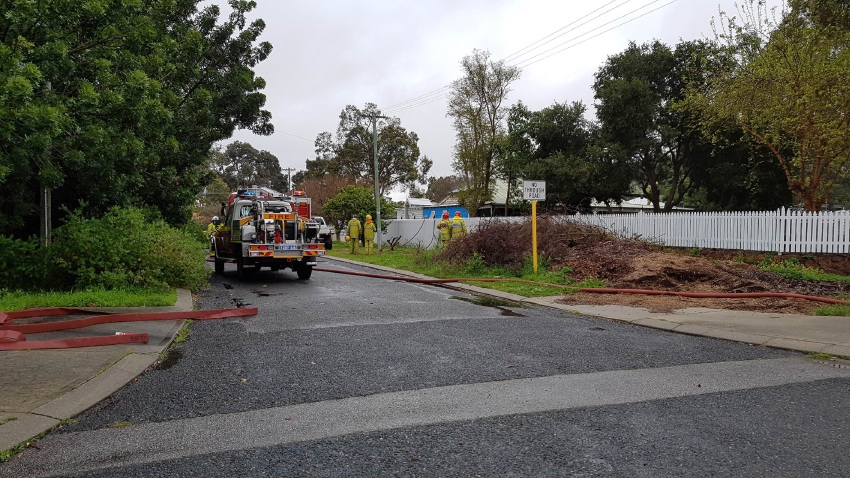 Fire crews at the house fire in Gooseberry Hill earlier today. Picture: staff photographer.