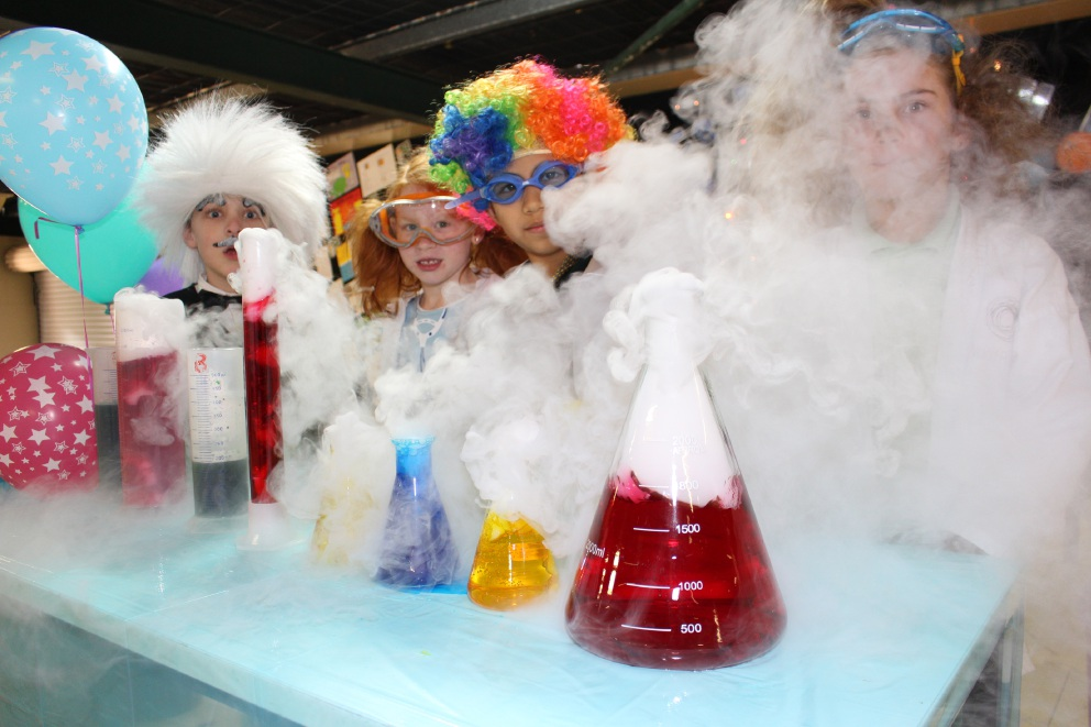 Oberthur Primary Year 2 students Alex Hunt, Elyce Chinnery, Josh Leonor and Holly McAnuff watch dry ice react with warm water.
