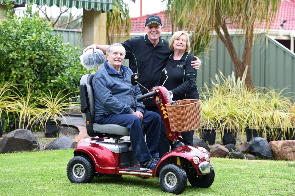 Bert Lane in his new wheelchair with Trish Page and Louis Doyle from 2nd Chance Op Shop.