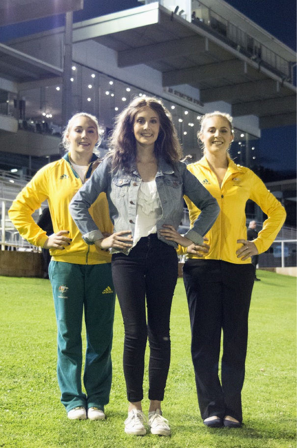 Harvey's Cureageous Olympic gymnasts Emily Little and Lauren Mitchell with cancer survivor Chloe Clements (centre).
