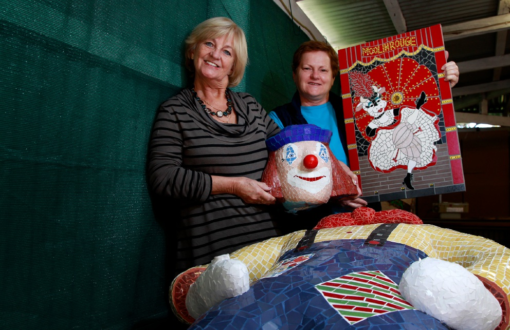 Anita Newman with her mosaic clown, which is almost ready after several years in the making.