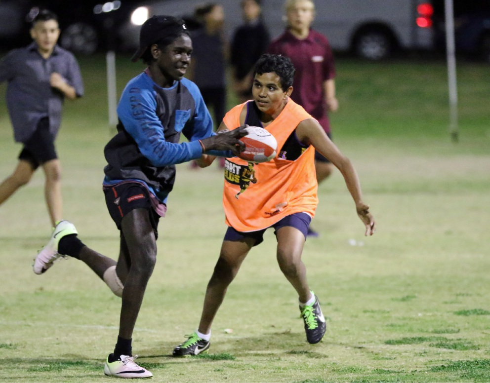 More than 100 young people from Kwinana and Mandurah came together to played a game of football and celebrated Indigenous culture as part of the NAIDOC session of the WA Football Commission's Night Fields program.