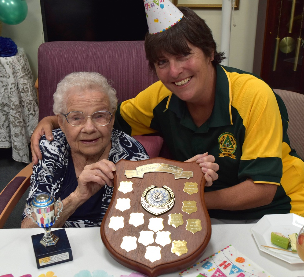 Connie House celebrates her 100th birthday with Halls Head Croquet Club president Carmel Hodges.