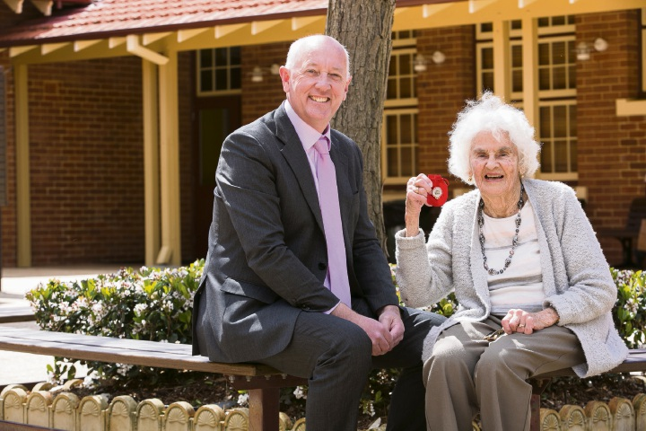 Margaret Lay with Minister Paul Miles.