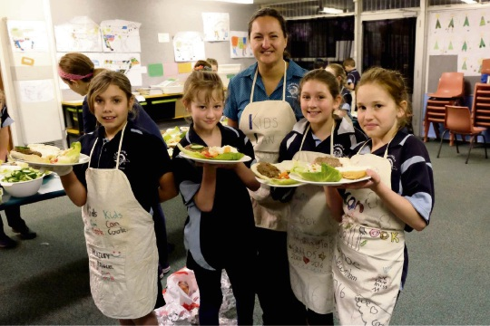 Carcoola Primary students crunch the numbers at dinner after maths enrichment program