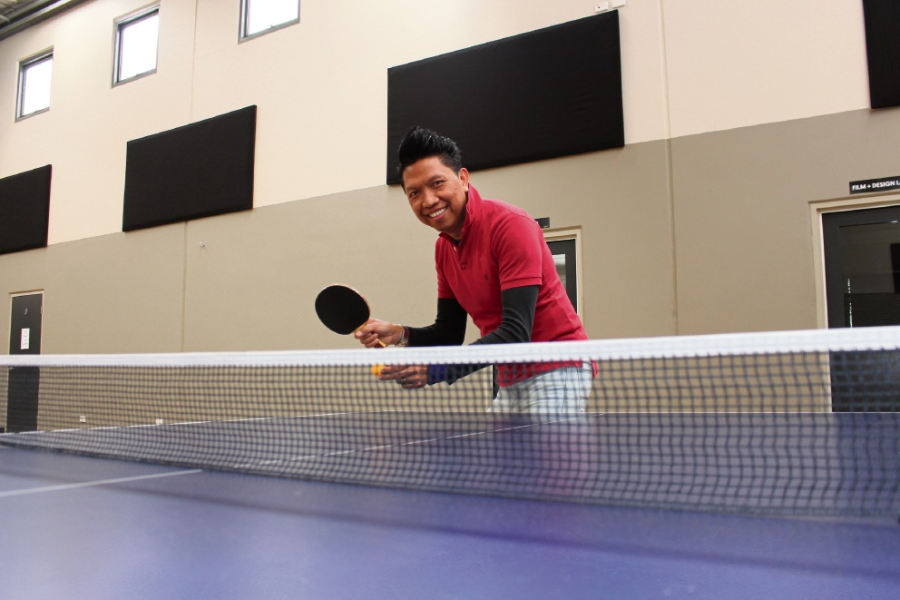 Mt Pleasant Baptist Church young adults pastor Jonathan Anthony prepares for this weekend's Ping-Pong-A-Thon.