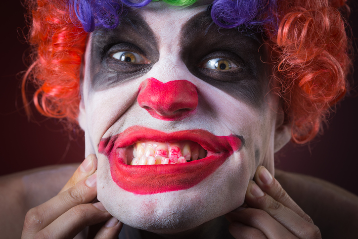 Evil Spooky Clown Portrait on dark background