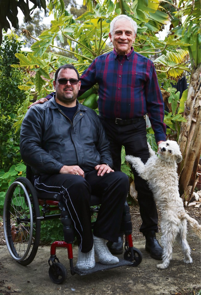 Adam and Joe Hewber with dog Max at their Palmyra home.