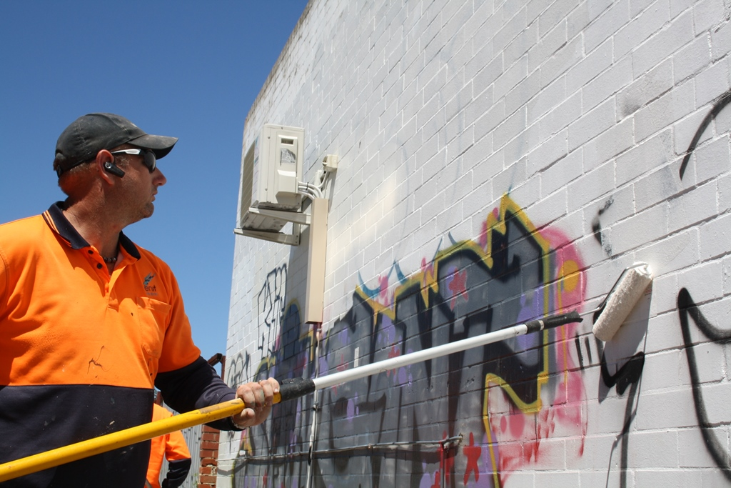 Troy Reeve tackling the scourge of graffiti. Picture: Giovanni Torre