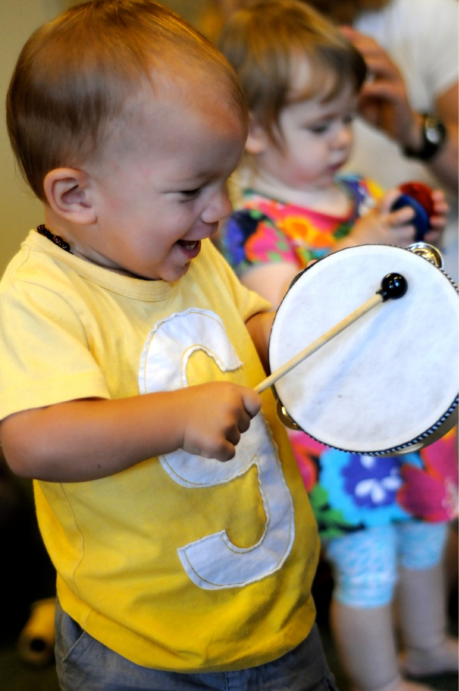 Tynan De Knock (15 months) and Margaret Aitken (14 months) at a Music Together workshop.
