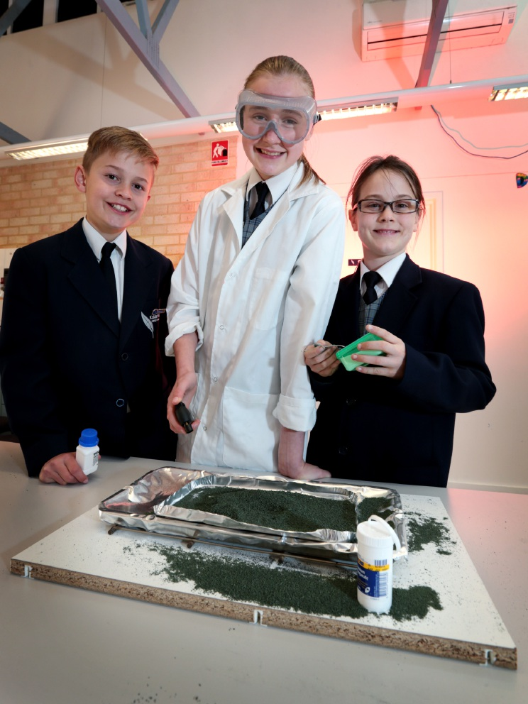 Liam Pabst, 11, Michaela Houghton, 11 and Anna Mae Plaistowe, 10 doing their science experiment. Picture: David Baylis