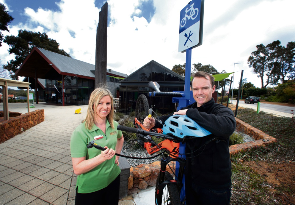 Jarree Murray and Tim Bennett at the Bike Repair station which has been installed in the Kalamunda Cultural Centre precinct. Picture: David Baylis.