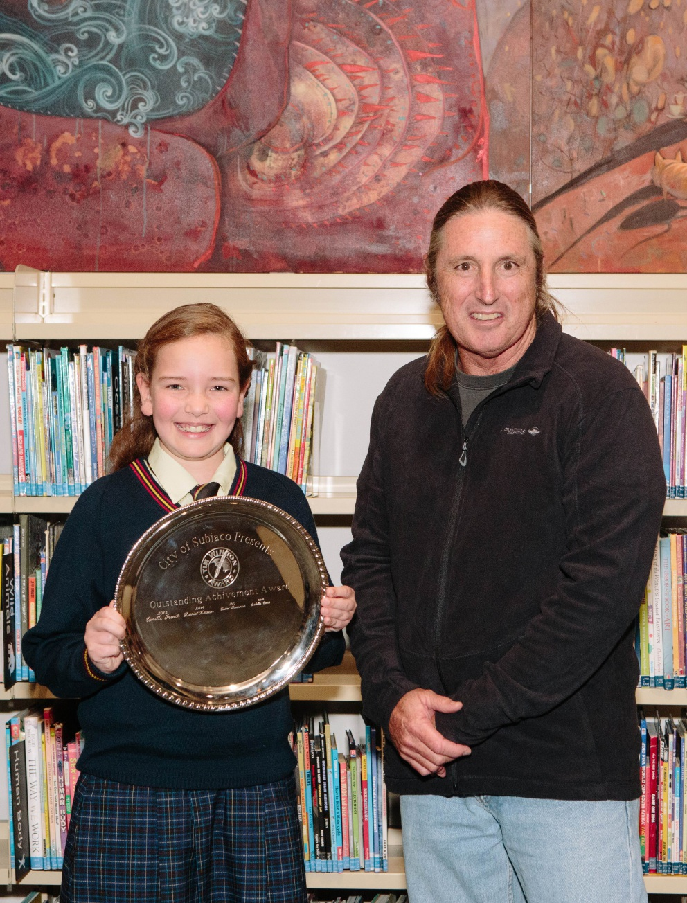 Tim Winton with the overall winner of the Tim Winton Award for Young Writers, Isabella Crean.