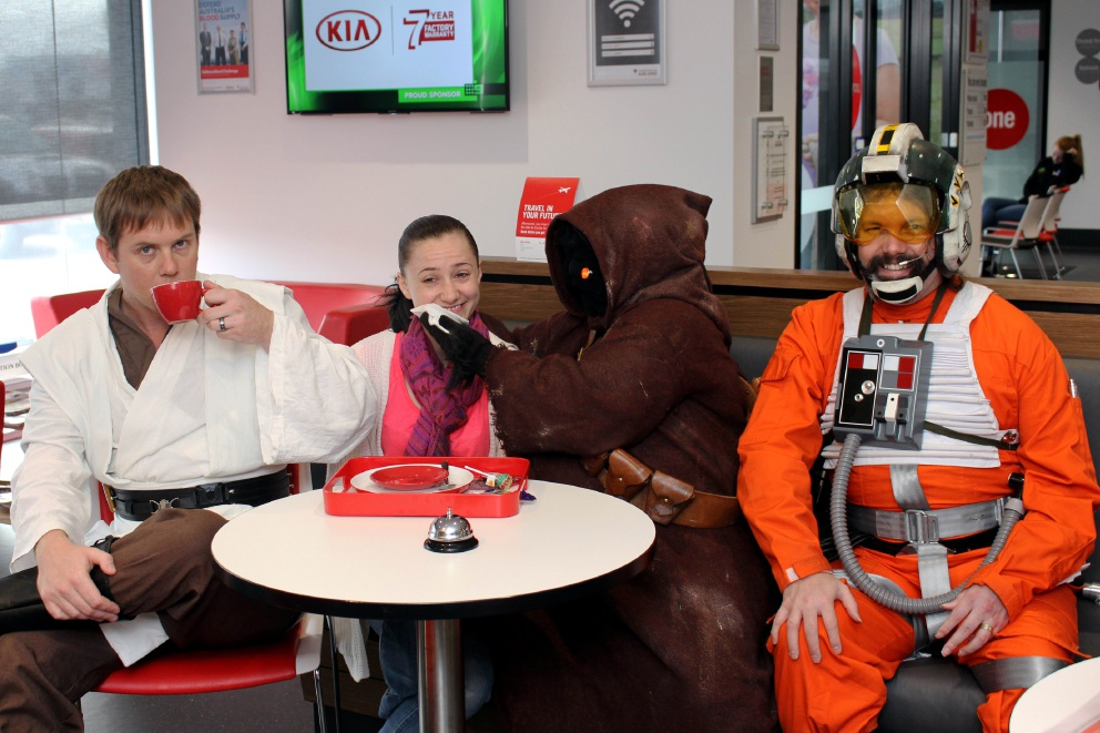 KC Carver, Rachel Corlett  and Shawn Hisey with  Jared Corlett were dressed as Star Wars characters at the Midland Blood Bank.