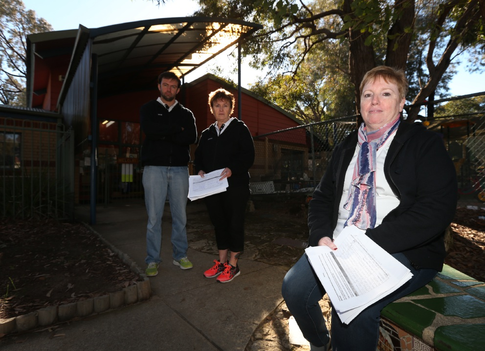 Director Clair Siaus with David Scheltema and Leanne Dodds at the Mundarda Child Care Centre, which could be forced to shut down because of State Government budget cuts. Picture: Matt Jelonek