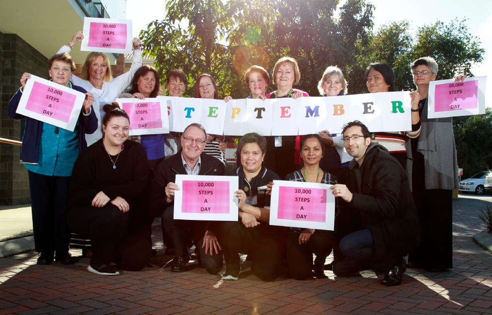 SwanCare chief executive Graham Francis (front, second from left) with Geraldine Garrett (co-ordinator of the Steptember initiative and manager of quality, standing seventh from left) together with SwanCare Bentley staff, all about to take part in Steptember. Picture: Marie Nirme