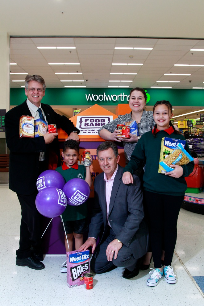 In front of the Foodbank WA collection hub at Carousel Shopping Centre are Steve Lockwood (Principal Bentley Primary School), Brayden Mathazia (6), Greg Hebble (Foodbank WA chief executive), Kate Holsgrove (regional manager Westfield WA) and Aaliyah Mathazia (10). Picture: Marie Nirme