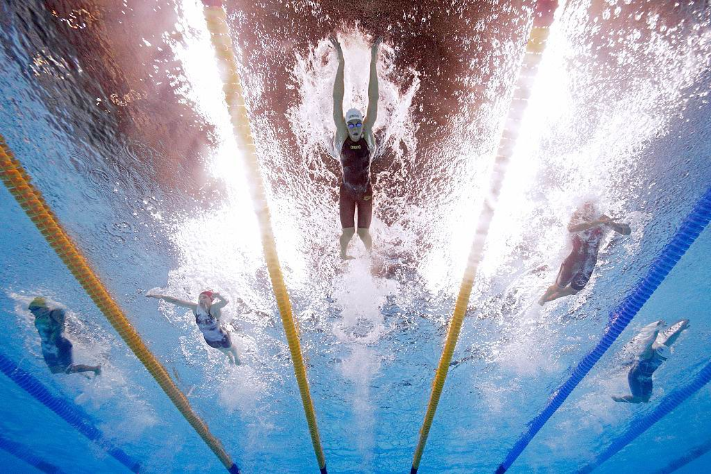 Blair Evans in the far left lane contests heat five of the 400m individual medley. Picture: Getty Images