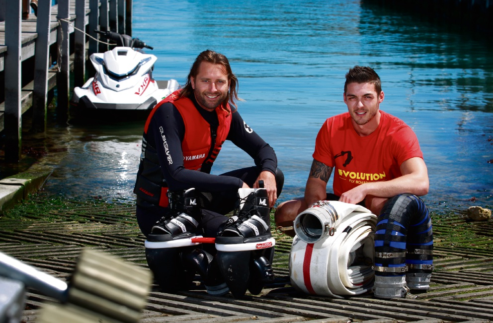 Business partners Colin Luthwood (on the board) and Sam Moland(on the jetski). Picture: Marie Nirme        d460559