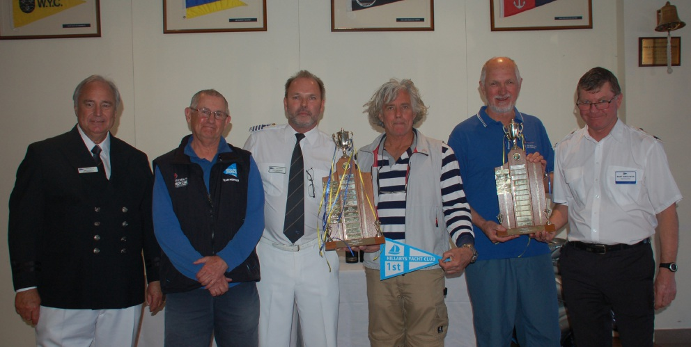 Rear commodore Brett Bailey, John Newman and commodore Simon Davenport with the Commodore Cup winners Bill Gilbert, Graham Atkinson and Bart Brouwer.