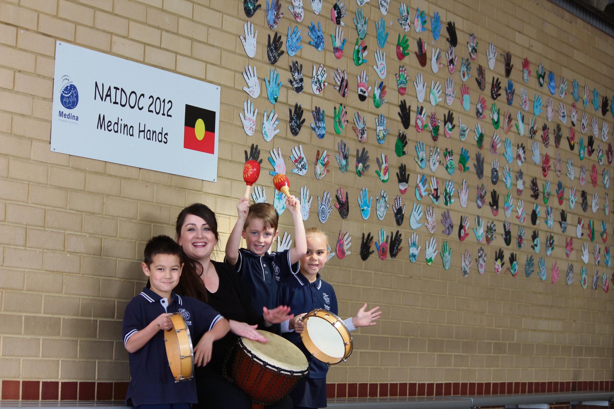 Medina Primary students Lochlan Macintyre (5), Koree Bayley (6) and Deborah Hall (6) with Crescendo teaching artist Michaela Ivory.