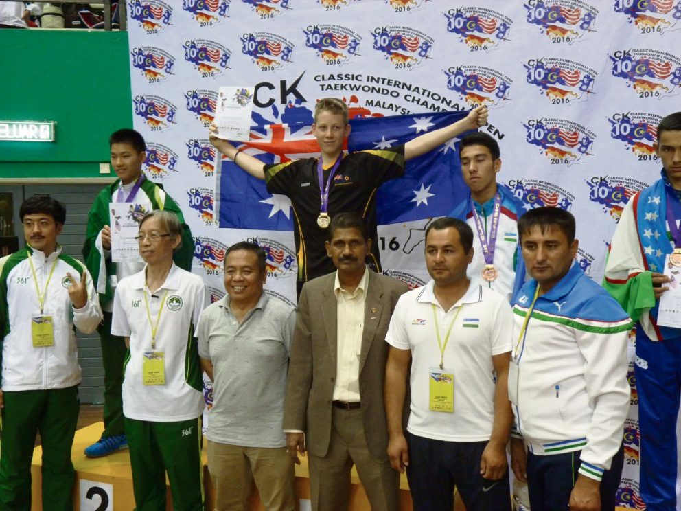Taekwondo champion Harrison McIntyre flies the Australian flag after winning a gold medal at the Malaysian Open.