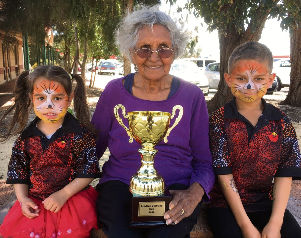Youngsters Susan and Martin join the 2016 winner of the Lindsay Culbong Cup, Margaret Culbong, at the Richmond Wellbeing Community Fun Day.