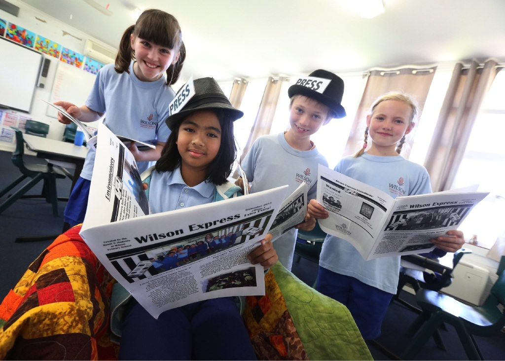 Year 4 students Amelie Anderson, Ana Gabriel, Charlie Dober and Grace Echermann with their newspapers.Picture: Matt Jelonek www.communitypix.com.au   d443601