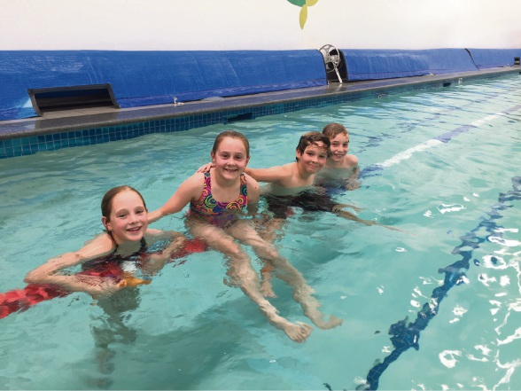 Elizabeth Eppen Van Der Aa, Olivia Payne, Anthony Eppen Van Der Aa and Lexcen King practise their swimming.
