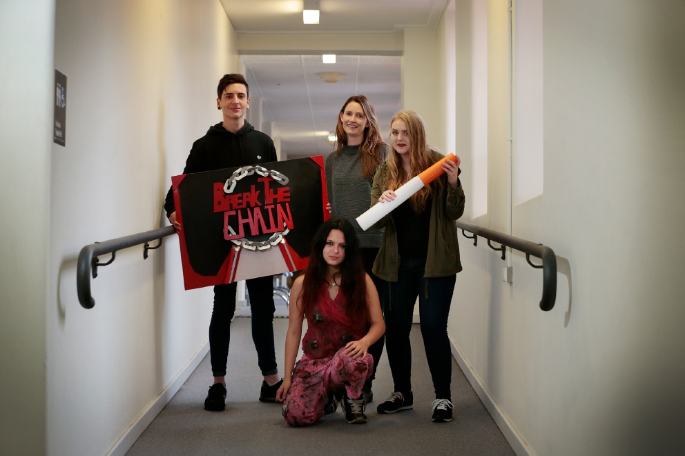 Daniel Di Fabio (17), Emily Box from Cancer Council, (front) Alyssia Andrews (17) wearing a diseased lung suit and Kayla Stockwell (16) highlight the dangers of smoking. Picture: Andrew Ritchie
