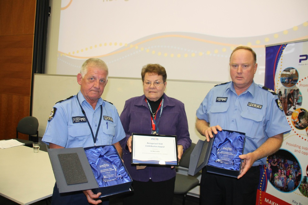 Kensington Youth Crime Intervention Officers Steve Hemingway and Ian Abercromby receiving the Recognised YCIO Award from WA PCYC board member Sue Gordon.
