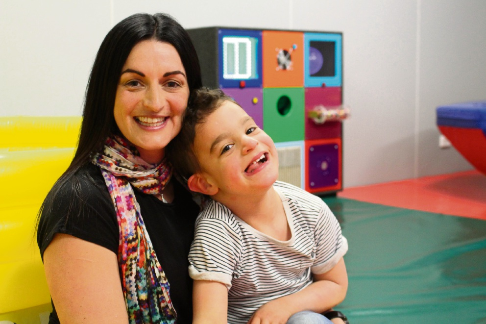 Maria Goss, who with her husband Luke raised $180,000 for the Sensory Xploration Hub, holds son Logan (4).