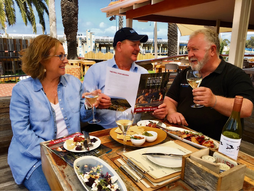 Peel Wine Association president Bernie Worthington (right) briefs visitors Jennifer and Malcolm King on the new Peel Wine Menu at The Heritage.