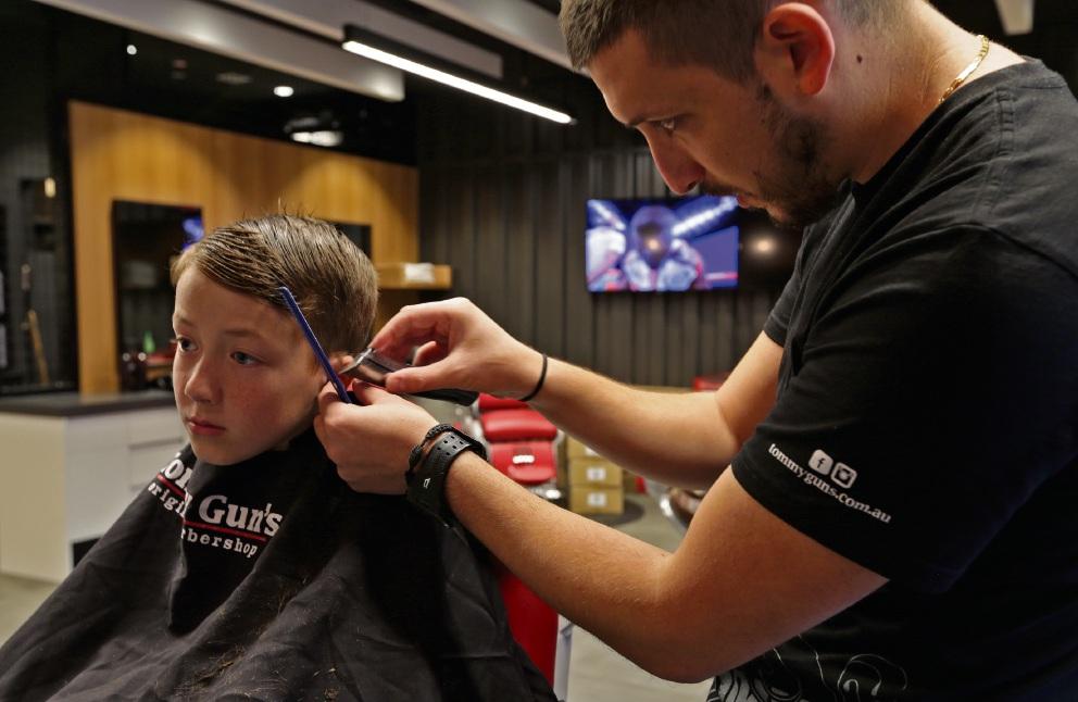Bojan Dimoski tends to Zac Kavarnos' hair. Picture: Martin Kennealey www.communitypix.com.au d457824