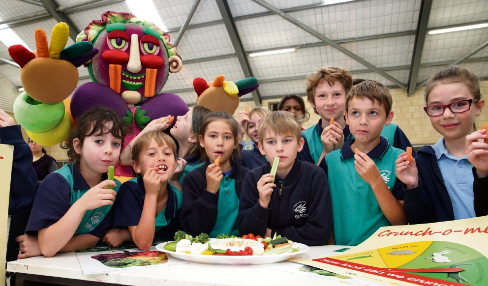 Padbury Primary School students tuck into some vegies. Picture: Martin Kennealey        www.communitypix.com.au d458960